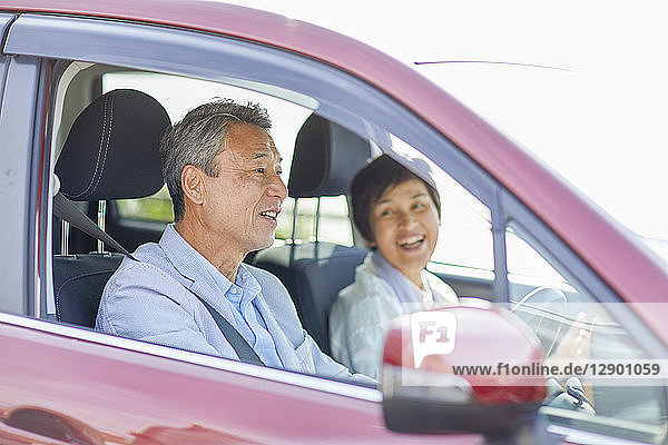 Japanese senior couple driving