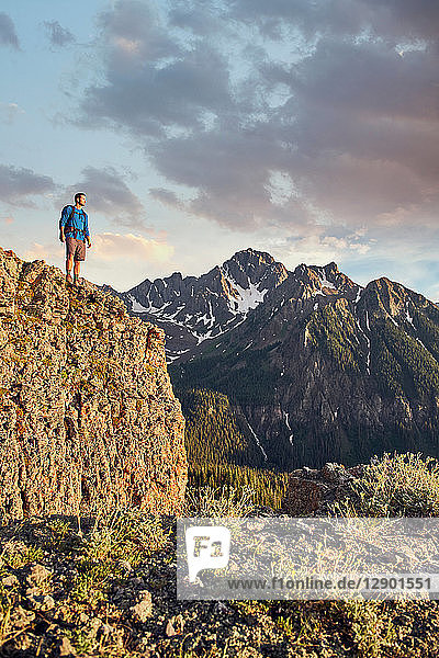 Hiker on mountain peak  Mount Sneffels  Ouray  Colorado  USA