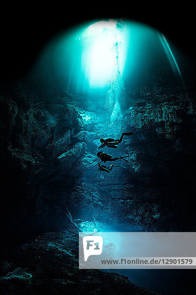 Freediver cavern diving in the pit cavern  Tulum  Quintana Roo  Mexico
