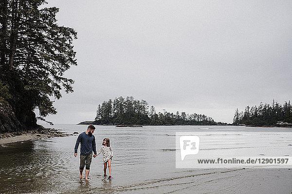 Father and daughter on beach  Tofino  Canada