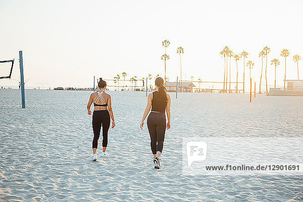 Friends walking on beach  Long Beach  California  US