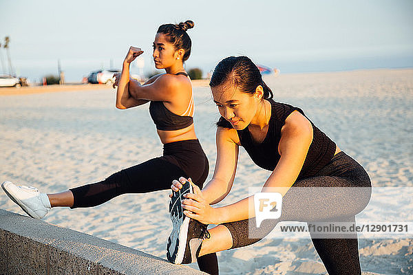 Friends doing exercises on beach  Long Beach  California  US