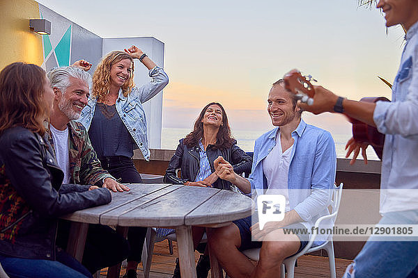 Friends at party by beach  Plettenberg Bay  Western Cape  South Africa