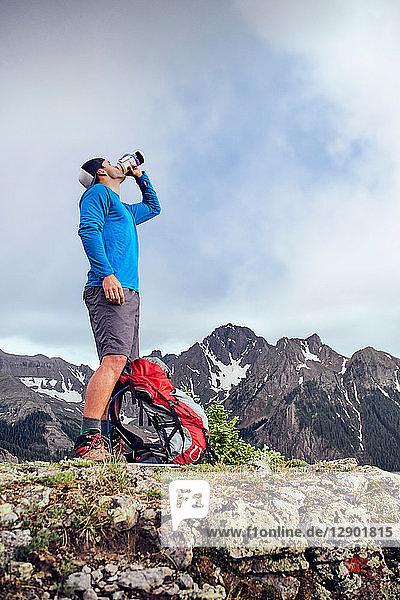 Hiker taking break  Mount Sneffels  Ouray  Colorado  USA