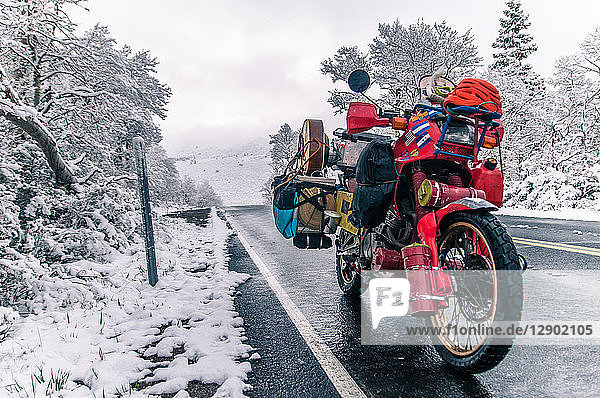 Touring motorcycle parked on roadside in winter  Placerville  California  USA