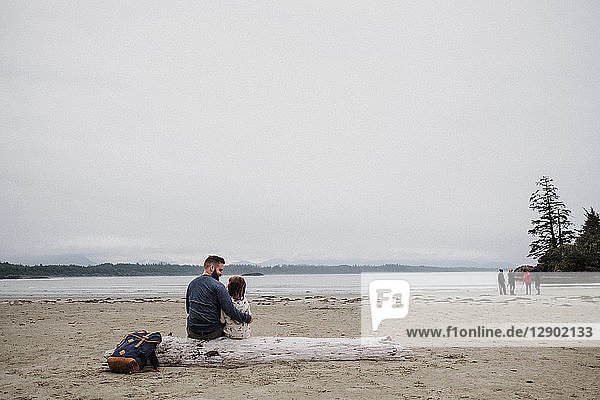 Father and daughter on beach  Tofino  Canada