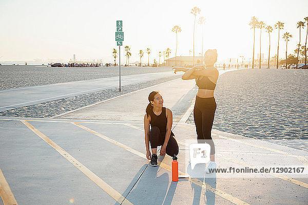 Friends doing exercises by beach  Long Beach  California  US