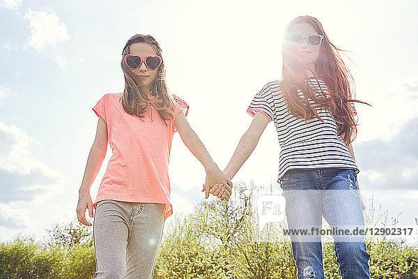 Best friends walking hand in hand