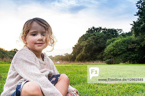 Child sitting on grass in park