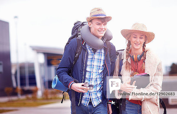 Backpacker couple at airport