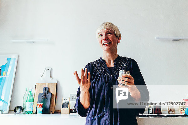 Woman smiling in kitchen