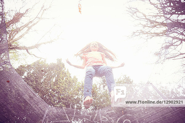 Girl jumping on trampoline  low angle view
