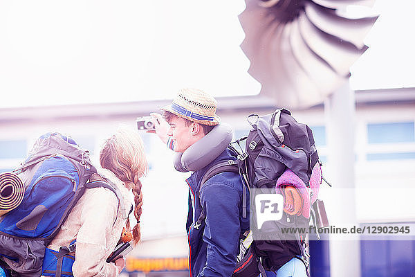 Backpacker couple taking selfie at airport