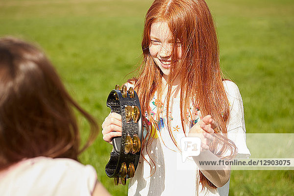 Girl playing tambourine