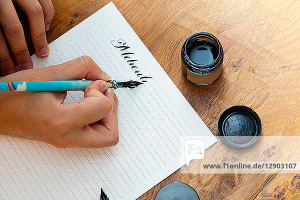 Woman writing with calligraphy pen