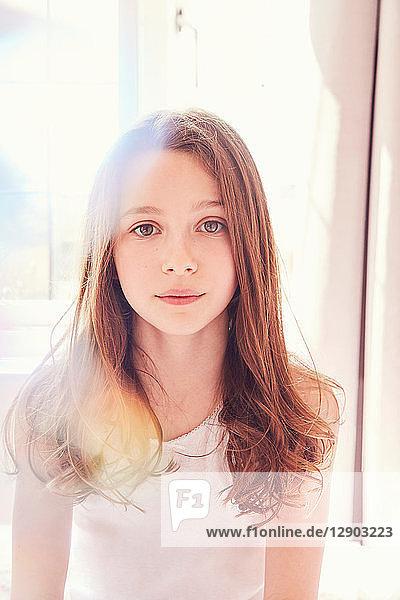 Portrait of girl in bright morning light