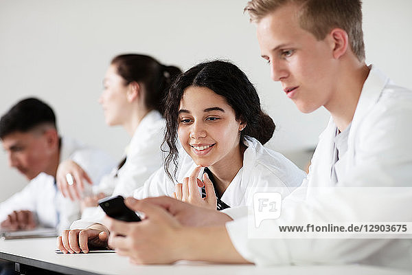 Students using cellphone in science class
