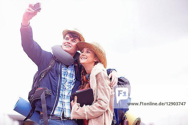 Backpacker couple taking selfie