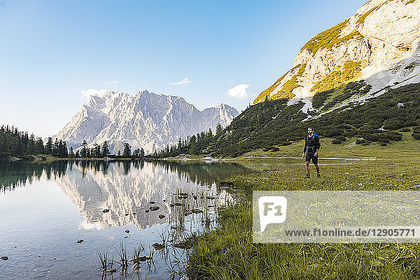 Austria  Tyrol  Hiker with backpack  hiking at Lake Seebensee