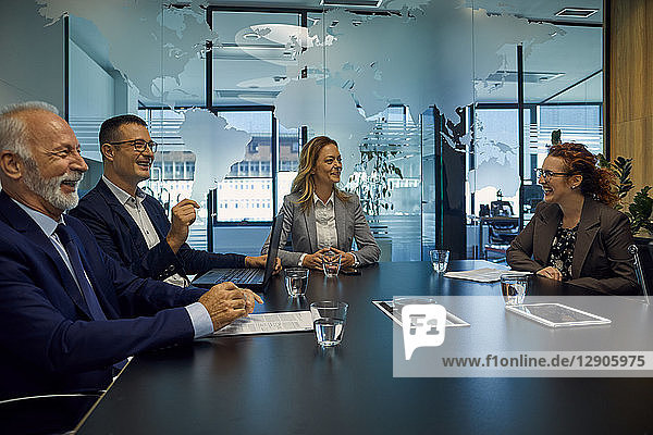 Group of happy business people having a meeting