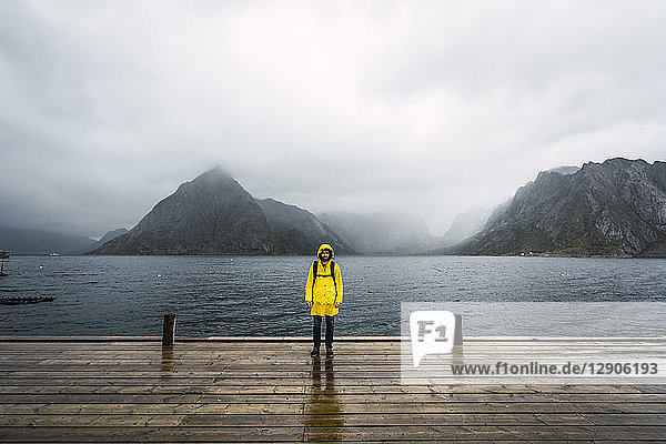 Norway  Lofoten  man standing on a pier at the coast
