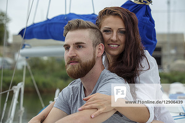 Portrait of a happy couple on a sailing boat