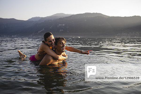 Happy carefree young couple in a lake
