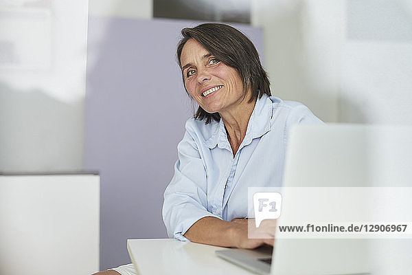 Portrait of smiling mature businesswoman in an office