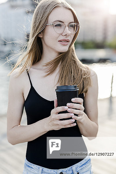 Young woman holding cup of coffee
