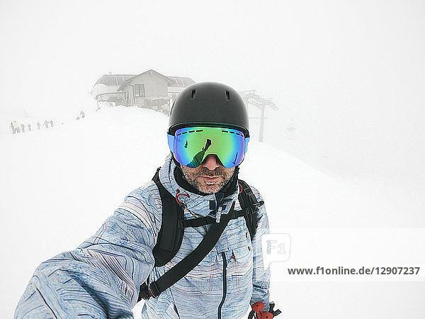 Italy  Modena  Cimone  portrait of man wearing ski goggles and helmet in haze