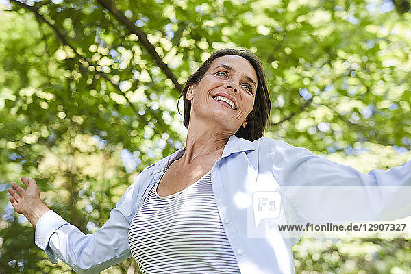 Portrait of relaxed mature woman dancing in nature