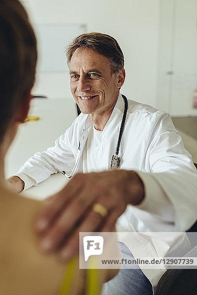 Doctor calming female patient