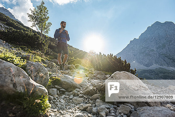 Austria  Tyrol  Young man hiking in the mountains