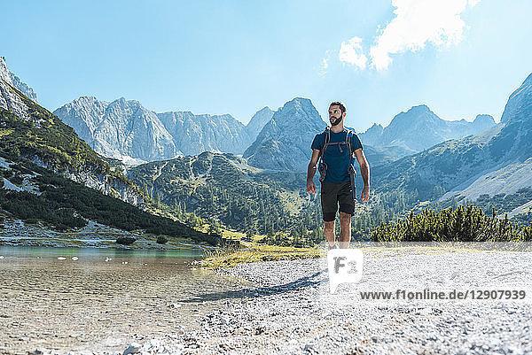 Austria  Tyrol  Man hiking at Seebensee Lake