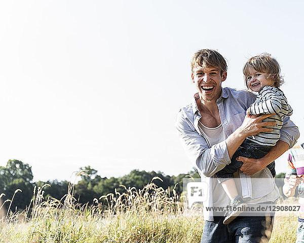 Father and son having fun at the river on a beautiful summer day