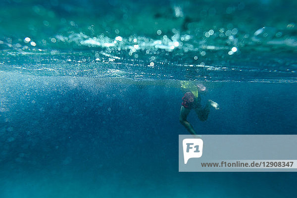 Boy swimming in the sea