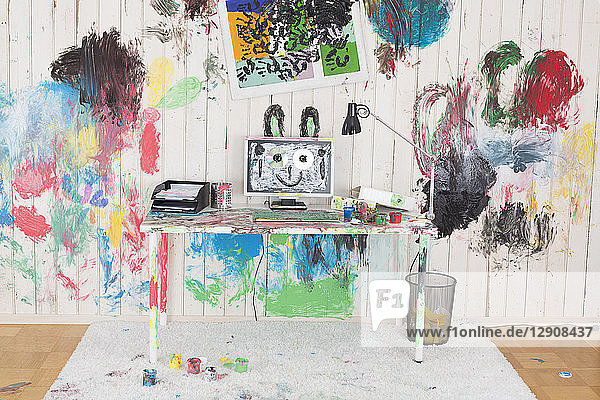 Office painted with colorful finger paint