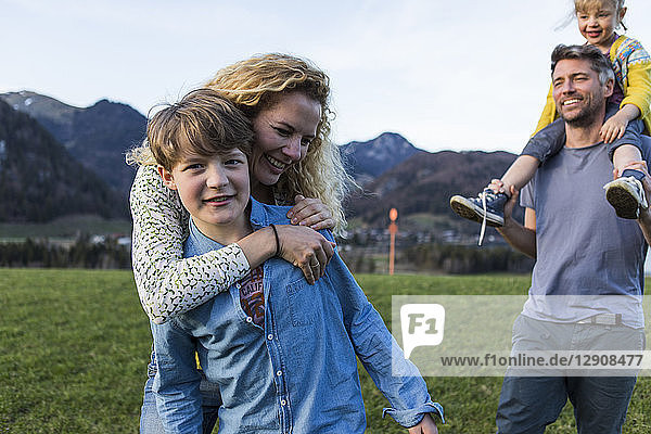 Austria  Tyrol  Walchsee  happy family hiking on an alpine meadow