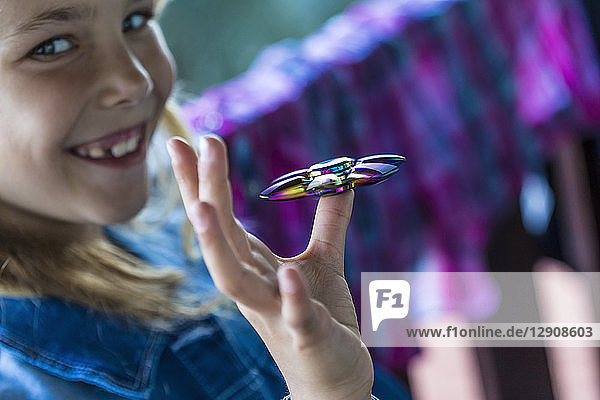 Happy girl with Fidget Spinner