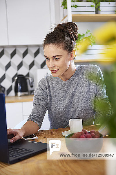 Young woman working from home  using laptop