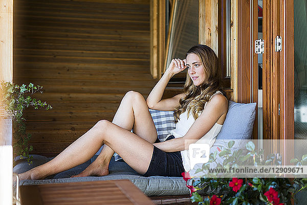 Long-haired woman relaxing on balcony