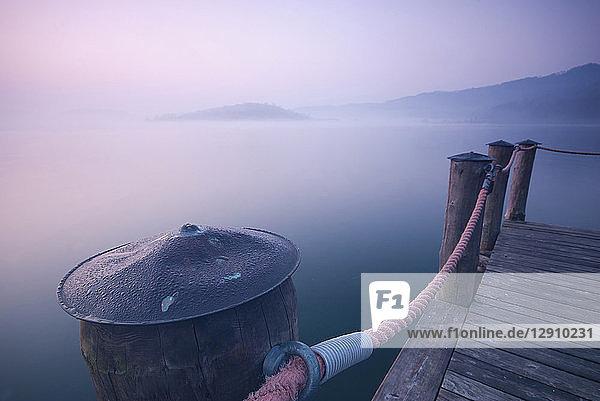 Italy  Piedmont  jetty at Lago Viverone at twilight