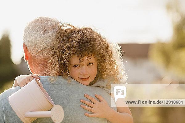 Portrait of little girl cuddling her uncle