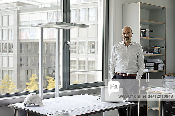 Successful engineer standing in his office