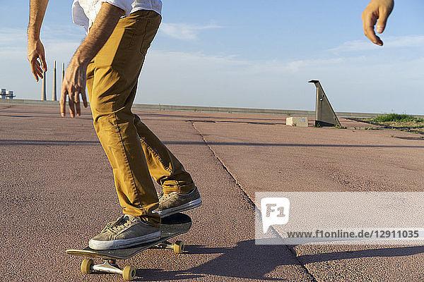 Legs of a skateboarder on a lane