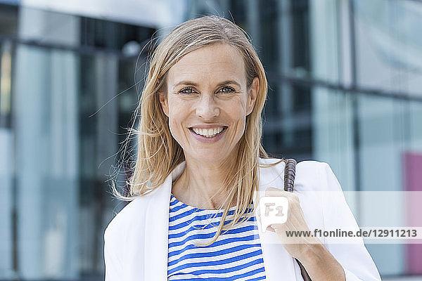 Smiling blond businesswoman