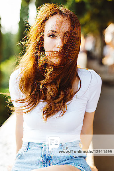 Portrait of redheaded woman with blowing hair