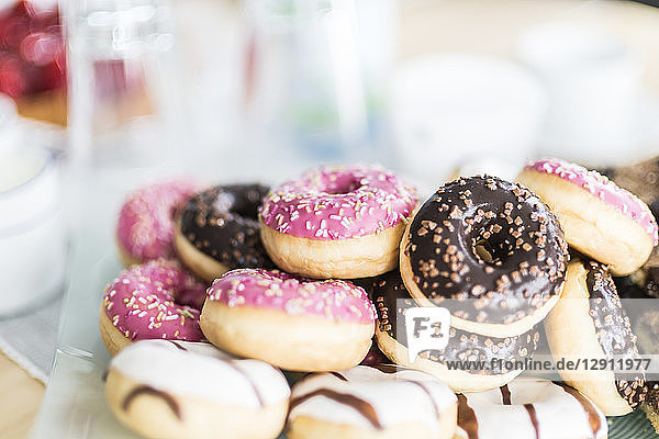 Various doughnuts with different icings and granules