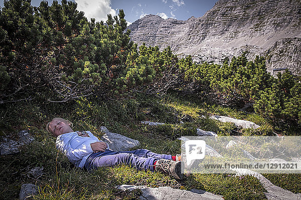 Austria  Salzburg State  Loferer Steinberge  girl resting on a hiking trip in the mountains
