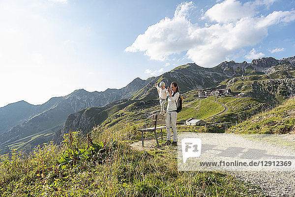 Germany  Bavaria  Oberstdorf  mother and little daughter on a hike in the mountains